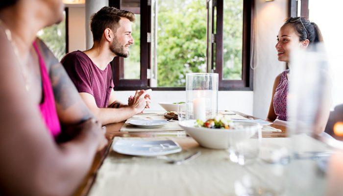 friends-having-dinner-at-a-restaurant-36QND4V